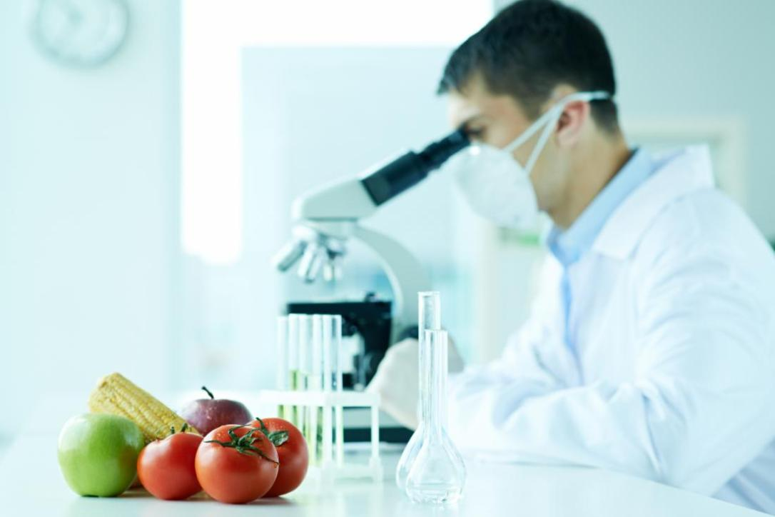 food-scientist-doing-research-with-microscope